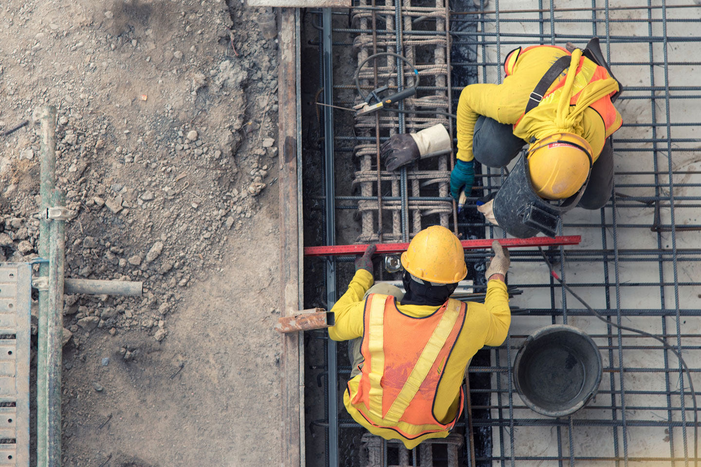 An aerial view of construction worker in construction site.